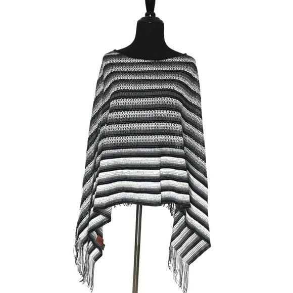 7ddf9508c1f5d Missoni Striped Fringe Poncho Black White Neutral. Missoni.  M_5a80a1cd85e605ddf67a904f. M_5a80a1cfc9fcdf1ad77050fe.  M_5a80a1cca825a697d1593d1a